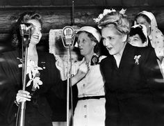 Mary Pickford taking a bow at the Hollywood Canteen after being introduced by Bette Davis. Photo: 1943. (LAPL 00059748) Bizarre Los Angeles