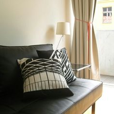 An architecture icon on the couch..minimal and storytelling