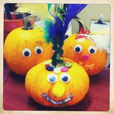 Google-eyed pumpkins with feather Mohawks!  A great young-child appropriate harvest craft.