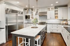 Carrara Marble and black island; contrasting black granite counter tops and white cabinets