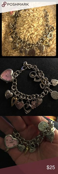 Brighton-style silver-toned bracelet Hearts galore shine on this silver-tone bracelet that includes a clock (needs a battery) and could be used as a watch.  Just in time for Valentine's or a gift of love Jewelry Bracelets