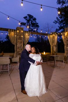 How romantic is this wedding photo?! The newlyweds took the opportunity to capture some nighttime photos under the glowing Edison bulbs on the back patio of their wedding venue. Love knows no boundaries. This interracial couples shows us that true love conquers all. Photo by MKM Photography, a Durham North Carolina based photography company.