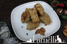 Soft morsels of #perch in #almond crust spiced with a few berries of #Sichuan #pepper - Fratelli ai Fornelli