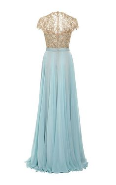 This **Reem Acra** gown is rendered in pale blue silk chiffon and features a sweetheart neckline with a short sleeve embroidered overlay, a fitted ruched bodice and a gathered floor length skirt with a split at the side.