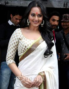 "Wow! The beauty of bollywood Sonakshi Sinha wore a lovely Creme Saree at the launch trailer of her upcoming film ""Lootera"" at Liberty cinema in Mumbai. The Chiffon Saree is laced up with a beautiful golden patti all around while the Banarsi broad neck blouse gives a pretty sophisticated look."