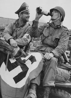 Normandy -  After being captured by the Germans on D-Day, Lt Baudin and Lehman celebrate their liberation. 508th PIR - 82nd Airborne Division  Picauville - Le Port Filiolet