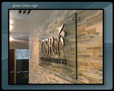 stone feature wall with corporate sinage - Google Search