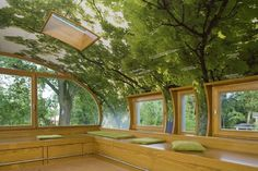 WOW- I believe that the trees on the rounded ceiling are actually a photograph that has been blown up and then applied like wallpaper. They don't line up with the actual trees outside the window on the front and there is a sky light as well...However,it's a great illusion & looks like it would be one really cool place to hang out...