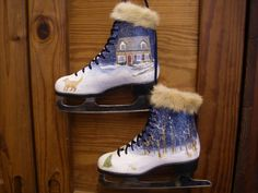 I hand painted some ice skates featuring my friend's home and dog, then trimmed them with mink