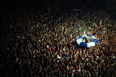band doing crowd surf at concert, on my bucket list :D