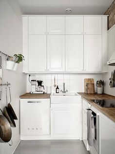 White kitchen with small SMEG fridge