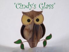 Hoot, hoot! Completely handmade in Tiffany style stained glass. Size is approximately 5.25 x 5.25.