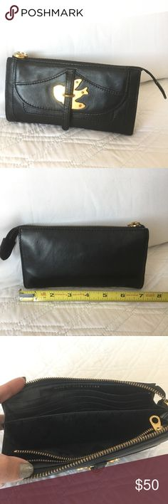 """Authentic Marc by Marc Jacobs Leather Clutch Authentic! Gorgeous black leather clutch/wallet from Marc By Marc Jacobs 💕Very spacious! Approximate measurements (not exact) 7 1/2"""" x 4"""" x 1"""" Hardware is yellow gold tone. Used and in good condition. NO TRADE ❌ Marc By Marc Jacobs Bags"""