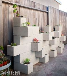 Cinder blocks are ugly. These cinder blocks, arranged to form a geometric planter, are modern and brilliant. And the whole thing goes so well with succulents, which have a sort of geometry to them too