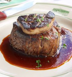 Filet Rossini - Filet Mignon with seared Foie Gras and Madeira demi glace.