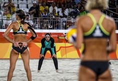 Kira Walkenhorst of Germany (L) signals to teammate Laura Ludwig (R) as Doaa Elghobashy of Egypt (C) watches during the women's Beach Volleyball preliminary pool D game between Ludwig/Walkenhors of Germany and Elghobashy/Nada of Egypt the Rio 2016 Olympic Games at the Beach Volleyball Arena on Copacabana Beach in Rio de Janeiro, Brazil, 07 August 2016.