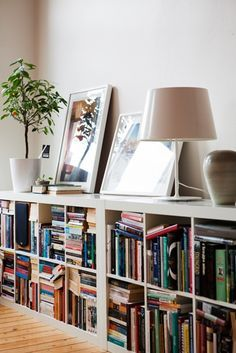How to Decorate a First Apartment (Without Going Broke) - Walmart Storage Ideas - Ideas of Walmart Storage Ideas - Just Graduated? 8 Things Every First Apartment Needs via Apartment Needs, First Apartment, Ikea Kallax Bookshelf, Ikea Expedit, Low Bookshelves, Bookshelf Styling, Low Shelves, Bookshelf Ideas, Long Low Bookcase