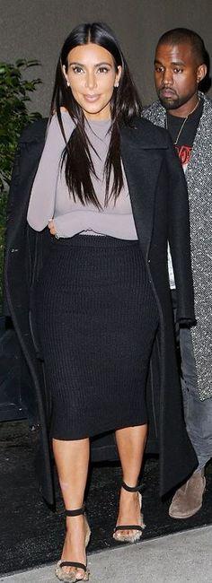 Who made Kim Kardashian's gray long sleeve and black fur sandals? Shirt – Wolford  Shoes – Celine