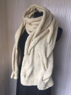 This extra long knitted scarf is a luxurious accessory that will provide much warmth as the winter season approaches. It is custom handmade from an exclusive blend of Virgin Wool and Superfine Alpaca to create a thick hooded scarf that will steal the spotlight each time you wear it.