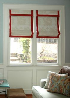 These functional Roman Shades have a 2 inch red banding around all three sides of the shade & along the valence edge. The white damask fabri...love the pops of red