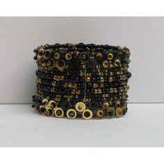 Bracelet extensible fait de billes et de paillettes.  Disponible en rouge, noir, gris et beige.