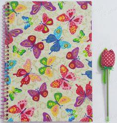 Caderno e caneta encapados artesanalmente com tecido.