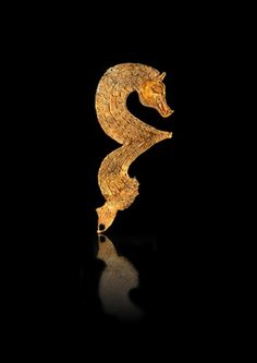 A engraved gold seahorse which is part of a treasure hoard of Anglo Saxon artifacts found in Staffordshire, UK