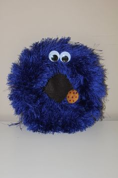 Cookie Monster Sesame Street Wreath. $20.00, via Etsy.  Who doesn't love Cookie Monster (the Original, who actually ate all the cookies!) my friend makes the most amazing wreaths at less than half the price you would pay from other vendors. Seriously. Check her out - she's amazing!