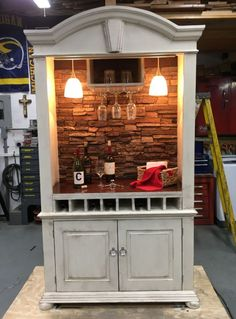 A creative DIY'er turned an old armoire into an art deco style bar cabinet using Norwich Stacked Stone panels. Refurbished Furniture, Bar Furniture, Repurposed Furniture, Furniture Makeover, Funky Furniture, Furniture Design, Diy Home Bar, Diy Bar, Bars For Home
