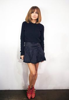 Short skirt, long sleeves, and boots. Nicole Richie