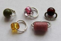 This lesson shows how make jump rings with gemstone, or any, beads on them. In other words, you will be able to create fancy jump rings, which can be used as connectors in a variety of projects; connected together for a necklace or bracelet design or attached to an ear wire for a simple pair of earrings. Try variations by using gemstone chips, seed beads or crystals too! From Albina Manning and Wire-Sculpture.com!