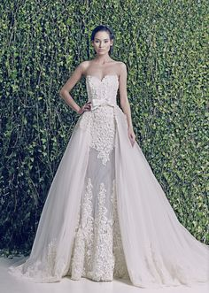 Dimitra's Bridal Couture. Zuhair Murad wedding dresses Chicago. www.dimitrasbridal.com #ZuhairMurad #Zuhairmuradweddingdresses #zuhairmuradbridalgowns #zuhairmuradweddinggowns #luxuryweddings #luxury #bridalcouture #celebrityweddings #designerweddingdresses #removabletrain #laceweddingdress #removablesleeve #sleeves #glamorous #classic #timeless #brides #weddings