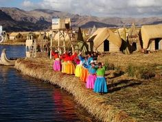 ... floating islands of Lake Titicaca welcome tour boats to their home