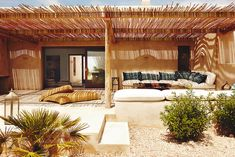 """This is the home of Eugenia Silva in Formentera: crafty villa that blend with the colors of the field. It's called 'Can Eu'. """"I first came to Formentera ten Exterior Design, Interior And Exterior, Outdoor Spaces, Outdoor Living, Casa Top, Turbulence Deco, Parasols, Primitive Homes, Bungalows"""