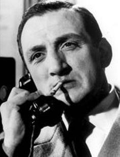 0 french actor LINO VENTURA on the phone