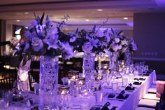 #reception #navywedding #weddingreception #bluelights #weddingdecor #whiteflowers #centerpieces