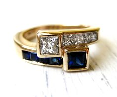 Diamond and Blue Sapphire Bypass 1.55ct Anniversary Engagement Ring 14kt Yellow Gold High Quality VS Diamonds SALE. $949.00, via Etsy.
