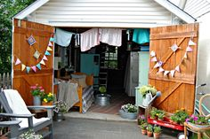 This charming she shed will inspire you to revamp your garage in a heartbeat.