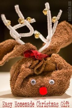 This easy homemade Christmas gift is perfect to have the kids help you make. This cute gift is perfect for teaches, neighbors, grandparents, and friends. You can fill it with whatever you'd like, but we used a bar of soap.Here's how to make this cute and simple reindeer towel gift: Supplies: Brown wash cloth White pipe cleaners 6 small bells Red ribbon Googly eyes Red pom-pom ball Bar of soap or alternate gift Hot glue gun You will make your reindeer towel by first folding your towel...