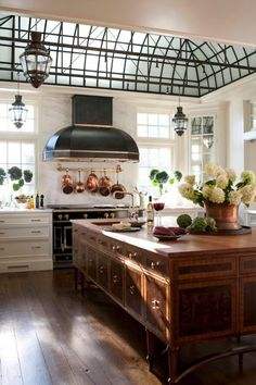 This feels like a farm kitchen, but look at the windows, contemporary, and a little industrial. Did you notice the hood over the ove...