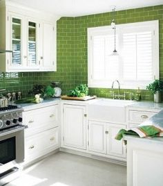 Love the bright green tiles against the white! Grey cabinets with orange tiles would be amaze