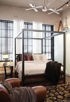 nice industrial loft bedroom.  I like the raw iron bed frame, the window treatments and the high shelf.