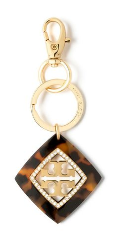 The Tory Burch McCoy pendant key fob proves it true: Even a set of keys can get dressed up for the season.