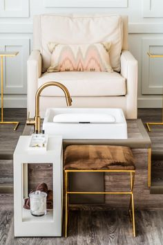 With a color palette of cream, blush and gold, this nail salon from M.A. Allen is both soothing and glamorous. Where upholstered armchairs provide comfortable seating for mani pedis, contemporary tables and an exposed ceiling create visual interest.