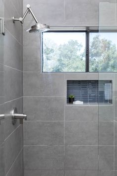 Calming shower interior design with gray tiles and blue accent tiles Accent Tile Bathroom, Small Bathroom Window, Gray Shower Tile, Gray Tiles, Window In Shower, Shower Niche, Bathroom Tile Designs, Bathroom Design Small, Bathroom Interior Design