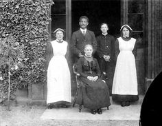 This group of servants represents a rather modest household. With a housekeeper (seated) and a butler, responsible between them for all the domestic arrangements. This group are in Pembroke Coillege, Oxford; they were possibly the staff of the Master's house