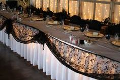 Maybe we could add something more the the head table?  Doesn't have to be lace, but something black (?)