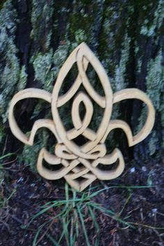 "Handcrafted from select 3/4"" Canadian pine, the Fleur de Lis, always thought as a symbol of France, is well placed in Scottish history with the Auld Alliance of the 13th century between Scotland and France. Celtic Knot Fleur de Lis measures 8-1/2"" x 8-3/4"".  Each piece is lovingly crafted and is ..."