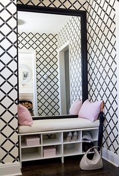 This entryway has the seat, storage and a mirror. It's also a segue into the next theme of using loud paint or wallpaper in these small spaces.