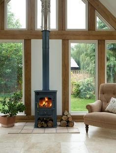 Garden room with log burner Clearview Solution 400 in a Border Oak building. Home Fireplace, Room Extensions, Oak Frame House, New Homes, House, Garden Room Extensions, Border Oak, Wood Burning Stove, Country Living Room